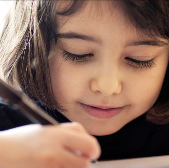 Young girl writing.